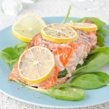 Baked salmon fillet with lemon and spinach Royalty Free Stock Photos