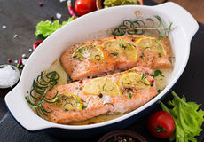 Baked salmon fillet with rosemary, lemon and honey. Stock Image
