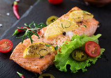 Baked salmon fillet with rosemary, lemon and honey. Royalty Free Stock Images