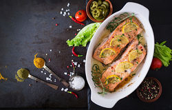 Baked salmon fillet with rosemary, lemon and honey. Royalty Free Stock Photography