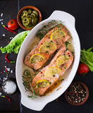 Baked salmon fillet with rosemary, lemon and honey. Stock Photos