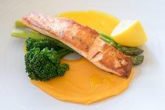 Atlantic Salmon With Sweet Potato Puree. Baked salmon fillet with seasonal vegetables on top of sweet potato puree Royalty Free Stock Image