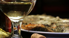 Baked salmon fish with aromatic herbs crust and wine, rotating stock video footage