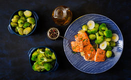 Baked salmon fish garnished with broccoli and Brussels sprouts with leek. Royalty Free Stock Photo