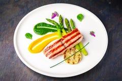 Baked salmon garnished with asparagus. Italian restaurant. Menu. stock photo