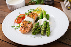 Baked salmon garnished with asparagus Royalty Free Stock Photos