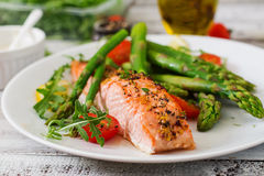 Baked salmon garnished with asparagus Stock Images