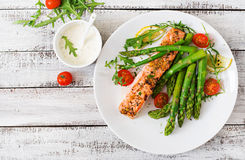 Baked Salmon Garnished With Asparagus Royalty Free Stock Photography