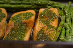 Baked Salmon and Greens. Baked Salmon with Asparagus and Peppers coated with parsley and garlic Stock Images