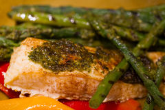 Baked Salmon and Greens. Baked Salmon with Asparagus and Peppers coated with parsley and garlic Royalty Free Stock Photo