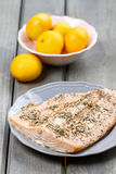 Baked salmon on grey plate Royalty Free Stock Photography