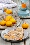 Baked salmon on grey plate Royalty Free Stock Image