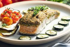Baked salmon with herbs eschar. Inside, indoor, indoors, interior, interiors, gastronomy, cuisine, foodstuff, aliment, aliments, meal, meals, alimentation stock image