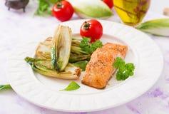 Baked salmon with Italian herbs Stock Photo