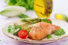 Baked salmon with Italian herbs Stock Photos