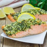 Baked salmon with macadamia cilantro crust on white plate, square format Stock Photography