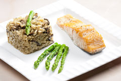 Baked salmon with mushroom risotto Royalty Free Stock Image
