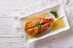 Baked salmon with orange on a plate. Horizontal top view Royalty Free Stock Photo