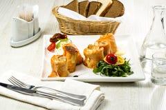 Baked salmon rolls Stock Photo