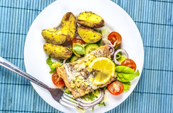 Baked salmon on salad with potatoes from above Royalty Free Stock Photography