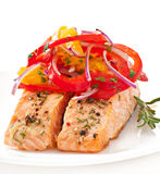 Baked salmon with a salad Stock Images