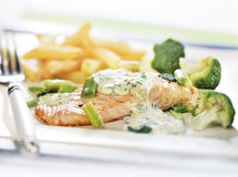 Baked salmon served on a plate Royalty Free Stock Photography