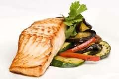 Baked salmon with side of eggplant and peppers Royalty Free Stock Images