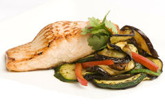 Baked salmon with side of eggplant and peppers Stock Photos