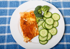Baked Salmon with Sliced Cucumbers Royalty Free Stock Images