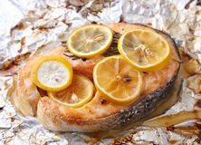 Baked salmon steak, appetite prepared fish. With seasoning on foil Stock Photos