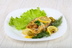 Baked salmon steak. With lemon and olives Stock Photo