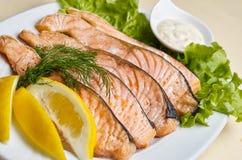 Baked salmon steak with stir-fry veggies. Stock Photos