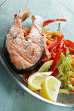 Baked salmon steak with vegetables Royalty Free Stock Photos