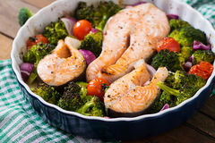 Baked salmon steak with vegetables Royalty Free Stock Photography