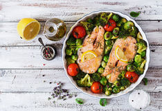 Baked salmon steak with vegetables. stock photos