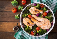 Baked salmon steak with vegetables. Stock Photography