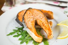Baked salmon steak. On a white plate Royalty Free Stock Photography