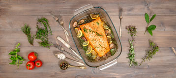 Baked salmon trout fish with fresh herbs and spices Stock Image