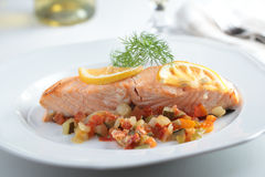 Baked salmon with vegetables Royalty Free Stock Photography