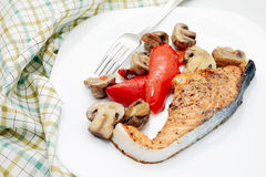 Baked salmon and vegetables Stock Photos