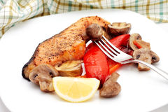 Baked salmon and vegetables Royalty Free Stock Photography