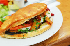 Baked sandwich with eggs and vegetables royalty free stock photography