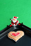 Baked by Santa with Love. Cookie baked by Santa with Love, room for copy space stock photo