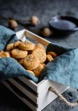 Baked Cheddar cheese crackers sprinkled with poppy seeds Stock Photography