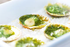 Baked scallop with herb butter. On wooden background royalty free stock photos