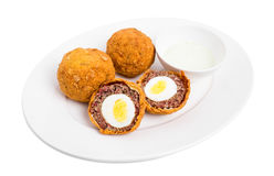 Baked scotch eggs with tartar sauce. Royalty Free Stock Images