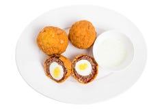 Baked scotch eggs with tartar sauce. Royalty Free Stock Photos