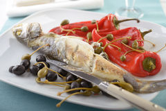 Baked sea bass with vegetables Royalty Free Stock Images