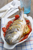Baked sea bream with vegetables Stock Photography