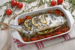 Baked sea bream with vegetables Stock Photo